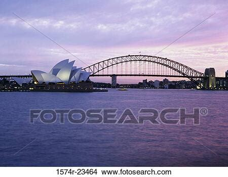 Opera house with a bridge on the waterfront, Sydney Opera